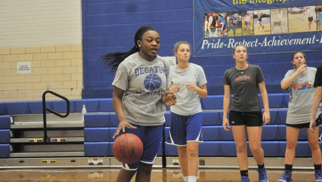 Stephen Decatur's Dayona Godwin dribbles as the hoops team held practice after the Bayside Championshio was postponed.