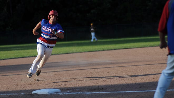 St. Clair Saints' Riley Gleason rounds third base Monday, June 19, during the SC4 Blue Water Area All-Star Game at Sanborn Park.