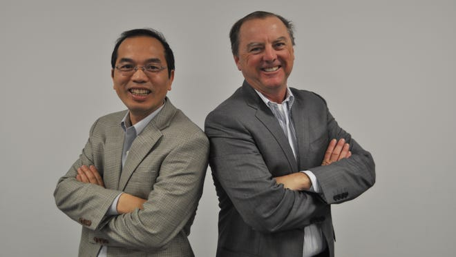 Under CEO Dr. Guanghui Hu's leadership, Admera Health is dedicated to developing cutting-edge diagnostics that span the continuum of care. He's pictured at left with Brady Millican, Admera's vice president of business development.