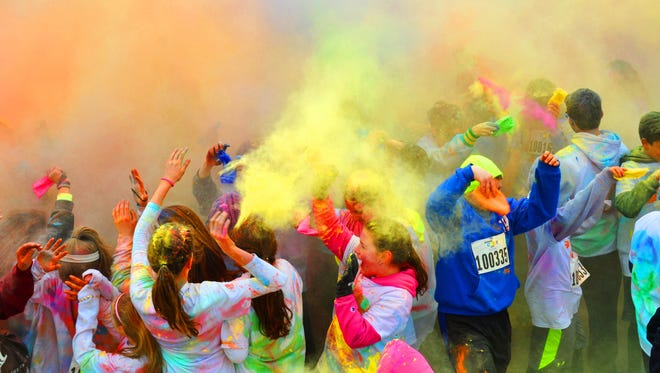 Following Montville Township High School Color Run, a 5K fundraiser, students, families, teachers and friends gather in the MTHS parking lot for the Color Burst, where powders of many colors are shot into the air.
