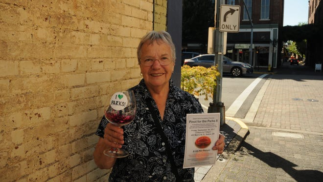 Carol Snyder holds a glass of fake pinot noir, but invited the public to support the Salem Parks Foundation by attending the Pinot for the Parks 8 event this Friday night.