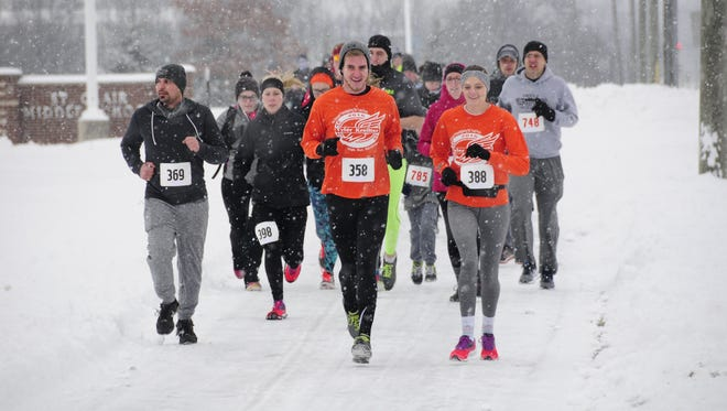 A pack of racers runs through the snow Saturday, Feb. 10, 2018 during the Chili Heart 5K. Snow is the forecast for Tuesday.