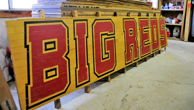 """Pieces of the old gym floors from Port Huron High School and Port Huron Northern High School are for sale. The largest and most expensive pieces, like this one which reads """"Big Reds"""" will be auctioned off."""