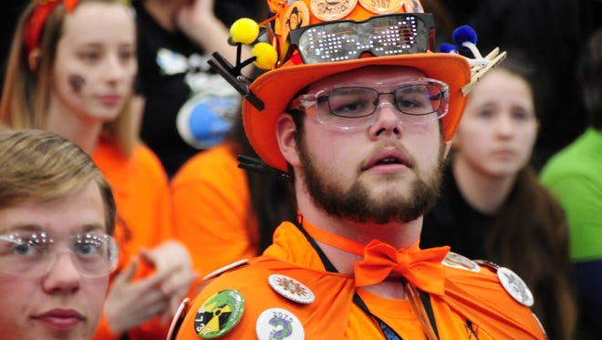Dion Stephenson, cheer captain for the Marysville Vi-Bots, looks on anxiously as his team competes in the FIRST Robotics District Event at Marysville High School on Saturday, April, 7, 2018. Police said he died Tuesday in a work place accident.