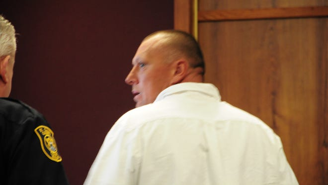 Coleman Wayne Suratt leaves Judge Daniel Kelly's courtroom after telling members of his family that he loves them.