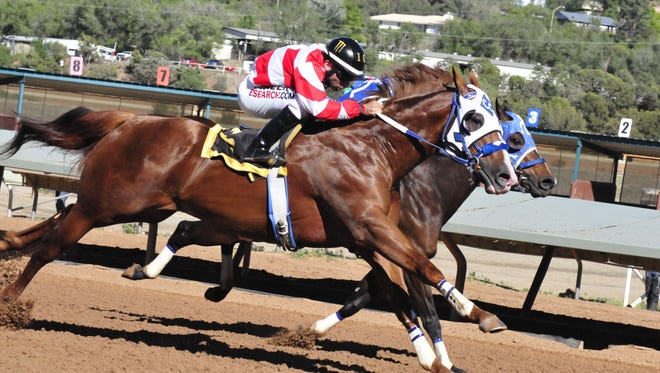 Horses race at Ruidoso Downs Racetrack and Casino.
