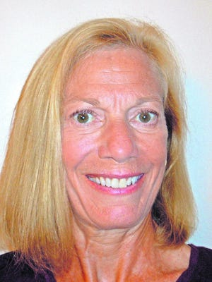 A native of Garden City, Julie Doll is a former journalist who has worked at newspapers across Kansas.