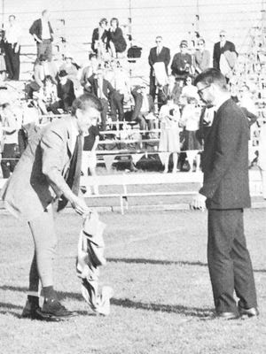 Larry Pressler, left, then the student body president at the University of South Dakota, follows a tradition by surrendering his pants to SDSU's Mike Raffety after SDSU beat USD in a 1963 football game.
