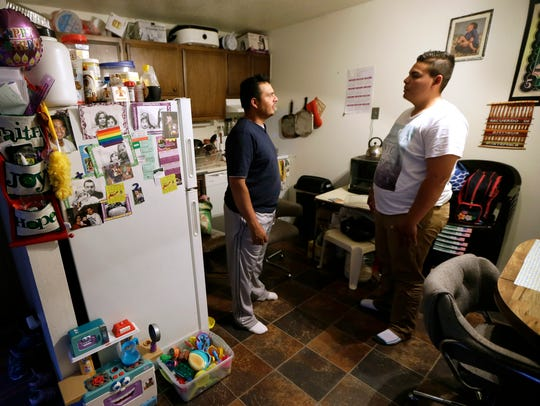 Alejandro Lopez, of Des Moines, Iowa, left, talks with