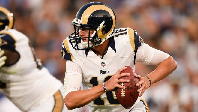 Los Angeles Rams quarterback Jared Goff (16) runs the ball during the second quarter against the Kansas City Chiefs at Los Angeles Memorial Coliseum.
