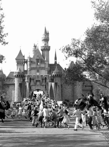 Children sprint across a drawbridge and into a castle