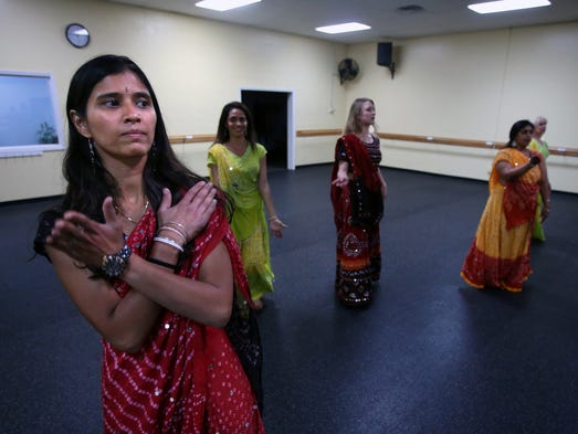 Swapna Deo, a member of<br /> Nachale Bollywood Dance Troupe, practices aroutine the group will be performing at the WorldFest.   Aug. 22, 2014