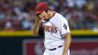 Arizona Diamondbacks starting pitcher Josh Collmenter (55) reacts after giving up a RBI single against he San Francisco Giants during the 3rd  inning of their MLB game Monday, April 6, 2015 in Phoenix, Ariz.
