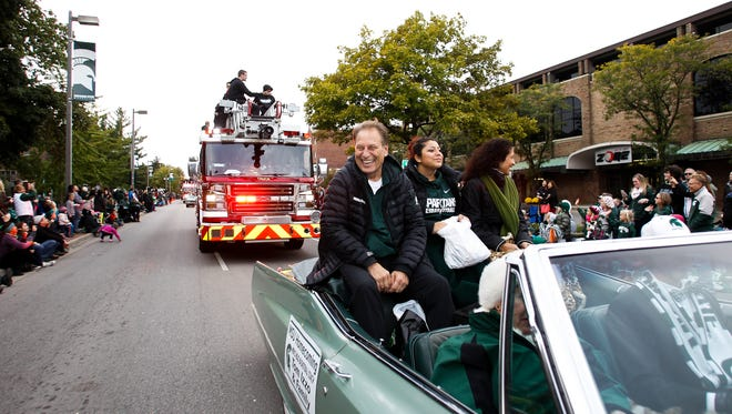 MSU Head Basketball Coach Tom Izzo with his daughter Raquel and wife Lupe, right, along the parade route during the 2015 MSU Homecoming Parade October 2, 2015 in downtown East Lansing.  [MATTHEW DAE SMITH | for the Lansing State Journal]