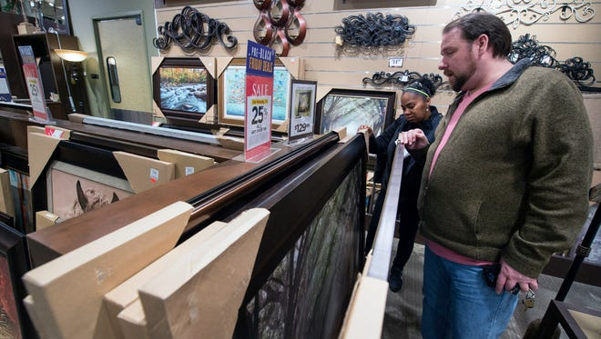 Neighbors Tracy Smith, left, and Jason Kaziska look for items to decorate their apartments in West York at Kirkland's at the West Manchester Town Center in the days before Black Friday. This is the store's second holiday season at the center, which is still being redeveloped.