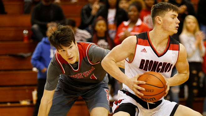 Matt Krause of West Lafayette tries to steal the ball from Maximus Grimes of Lafayette Jeff late in the Franciscan Health Hoops Classic championship Saturday, December 2, 2017, at Lafayette Jeff. Jeff defeated West Lafayette 41-40.