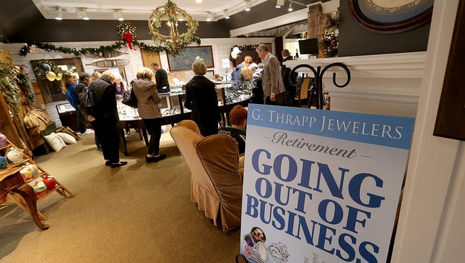 G. Thrapp Jewelers is closing after more than 30 years in Indianapolis. Here customers look for bargains during Gary Thrapp's retirement sale at the jewelry store at 5609 N. Illinois St.