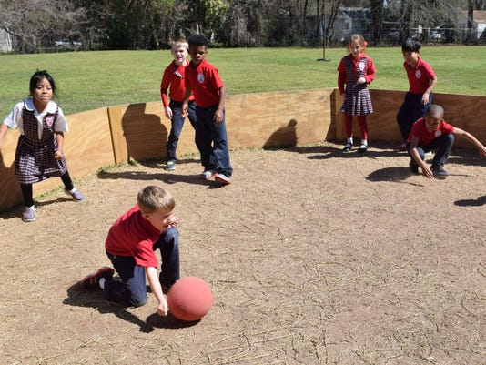 "St. Frances Cabrini school students play a game called ""Gaga."" Students have to hit the ball with their hands to tag out the other students. The ball has to hit below the waist to get another person out. It cannot hit above the waist otherwise the student that hit the ball is out."