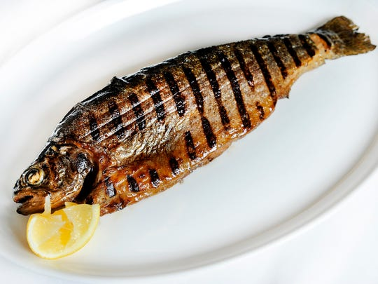 Whole sunburst trout is brushed in olive oil and lemon