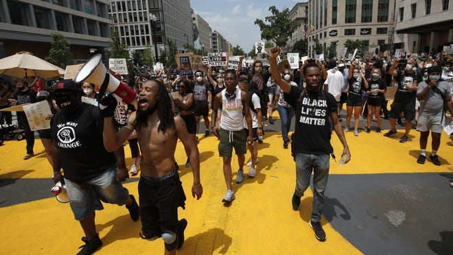Demonstrators protest Saturday, June 6, 2020, near the White House in Washington, over the death of George Floyd, a black man who was in police custody in Minneapolis. Floyd died after being restrained by Minneapolis police officers.
