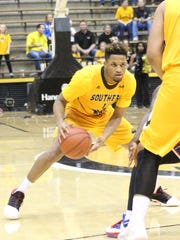 Southern Miss guard Cortez Edwards makes a move toward the basket in Sunday's Conference USA opener against Louisiana Tech at Reed Green Coliseum.