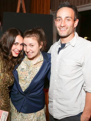 Girls' writer Murray Miller is accused of sexually assaulting actress Aurora Perrineau in 2012 when she was 17.  Miller denies the accusation.  He's seen here with Audrey Gelman, left, and Girls star Lena  Dunham, in this 2012 file photo.