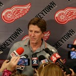 Former Detroit Red Wings hockey coach Mike Babcock who was hired by the Toronto Maple Leafs earlier this week talks to the media in the teams locker room at Joe Louis Arena in Detroit, Michigan on Friday, May 22, 2015.Babcock is leaving the Red Wings after 10 years in the organization, many playoff wins and 1 Stanley Cup.