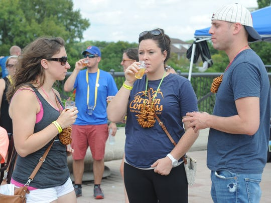 Attendees at a past year's Beers Across the Wabash gather on the pedestrian bridge.