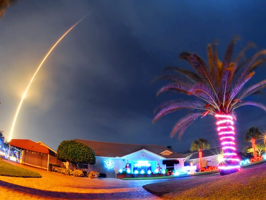 A SpaceX Falcon 9 rocket lifts off over Cocoa Beach,
