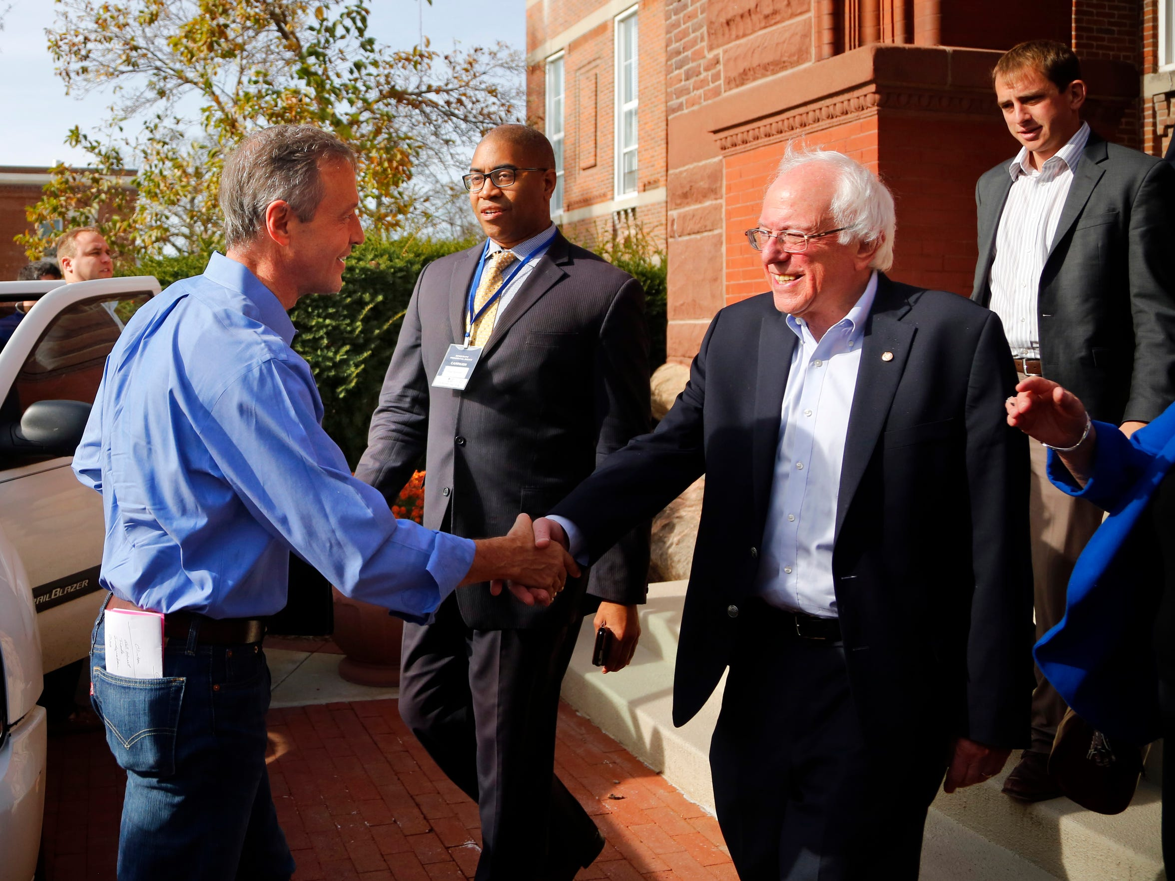 Democratic presidential candidates former Maryland Gov. Martin O'Malley and Sen. Bernie Sanders, I-Vt., shake hands outside Sheslow Auditorium on the Drake University campus before a Democratic presidential primary debate, Saturday, Nov. 14, 2015.