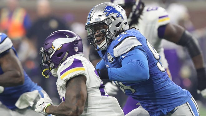 Lions defensive end Ziggy Ansah chases Minnesota Vikings running back Jerick McKinnon in the second half Thursday, Nov. 24, 2016 at Ford Field in Detroit.