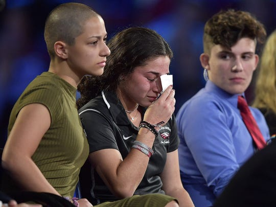 Marjory Stoneman Douglas High School student Emma Gonzalez comforts a classmate during a CNN town hall meeting, Feb. 21, 2018, at the BB&T Center, in Sunrise, Fla.