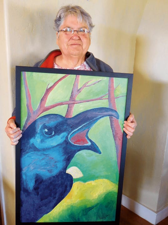 Grant County Art Guild member Dawn Byrum showing her colorful oil painting that was previously entered in the 2015 Southwest Birds Show. Courtesy Photo