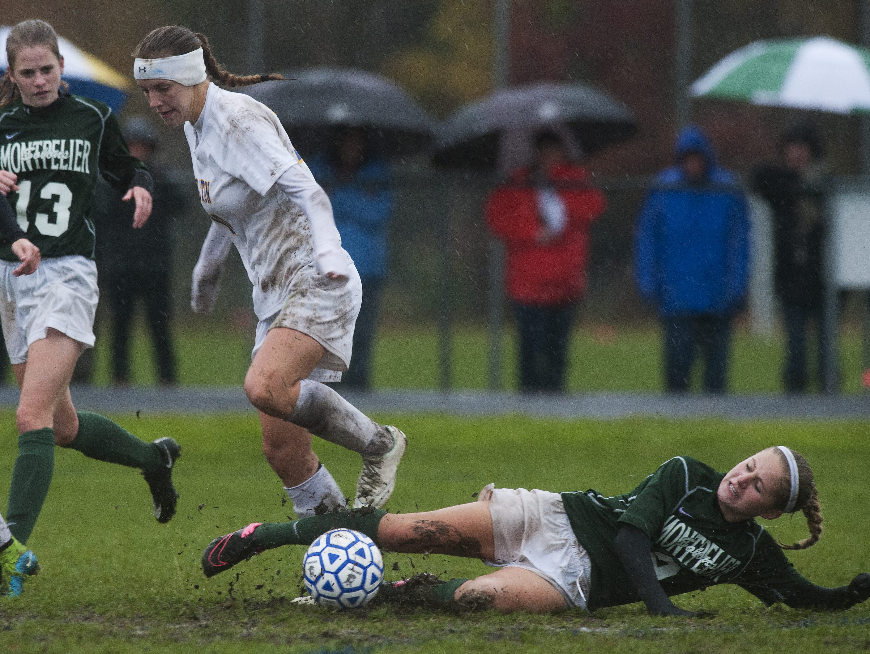 Montpelier's Maralina Moore (2) tries to slide tackle Milton's Caitlyn Dabagian (10) during the Division II high school girls soccer semifinals Wednesday.