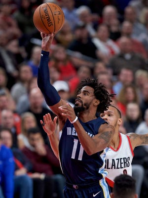Memphis Grizzlies guard Mike Conley, left, shoots over Portland Trail Blazers guard Shabazz Napier, right, during the first half of an NBA basketball game in Portland, Ore., Tuesday, Nov. 7, 2017. (AP Photo/Craig Mitchelldyer)