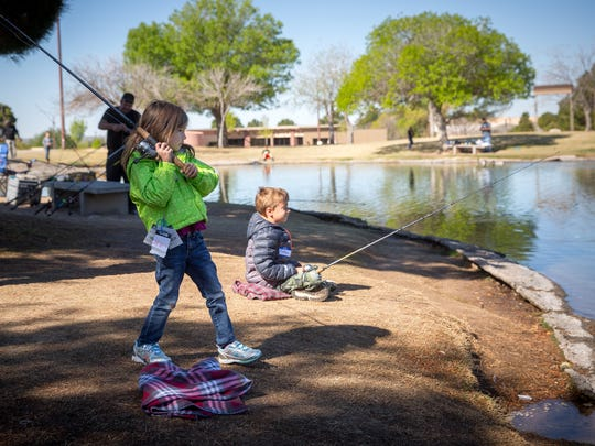 6-year-old Lainey Womack and her brother 7-year-old Nathan Womack try their hand at fly casting during a Kids Fishing Clinic sponsored by the Mesilla Valley Fly Fishers group and the New Mexico Department of Game & Fish at the NMSU Alumni Pond, April 2, 2016. According to the Mesilla Valley Flyfishers the Alumni Pond was stocked with 300 trout several days earlier for the kids to catch.