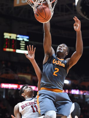 Tennessee forward Ray Kasongo (2) dunks over Ole Miss forward Sebastian Saiz (11).