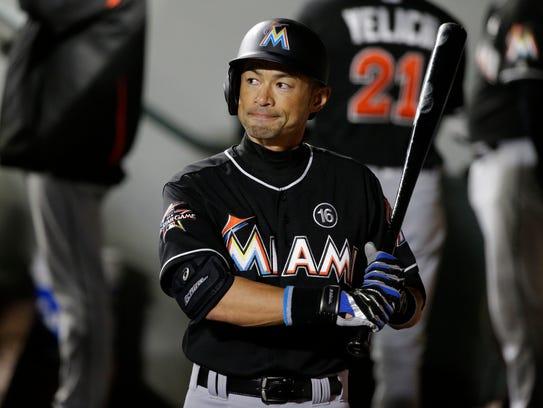 The Miami Marlins' Ichiro Suzuki reacts in the dugout