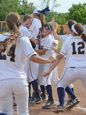 Hartland's softball players celebrate after clinching a Division 1 district title on Monday. The Eagles will take on Waterford Kettering in a regional semifinal at Novi on Saturday.