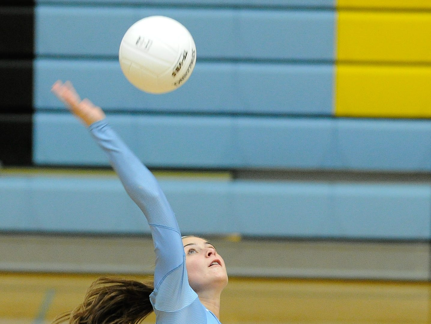 Cape's #6 Alison Palmer with a spike in the first game against Conrad Thursday night at Cape Henlopen High School.
