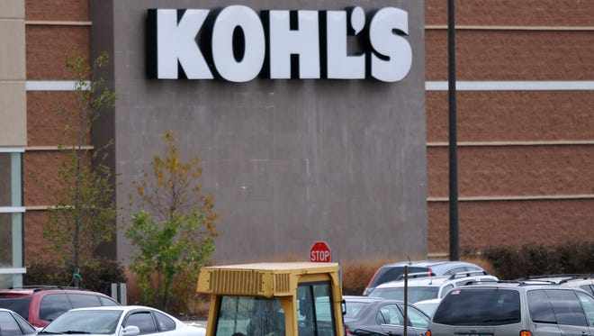 A bulldozer clears ground next to Kohl's in Richmond Village Center on Nov. 5, 2010, for construction of a new Best Buy store.
