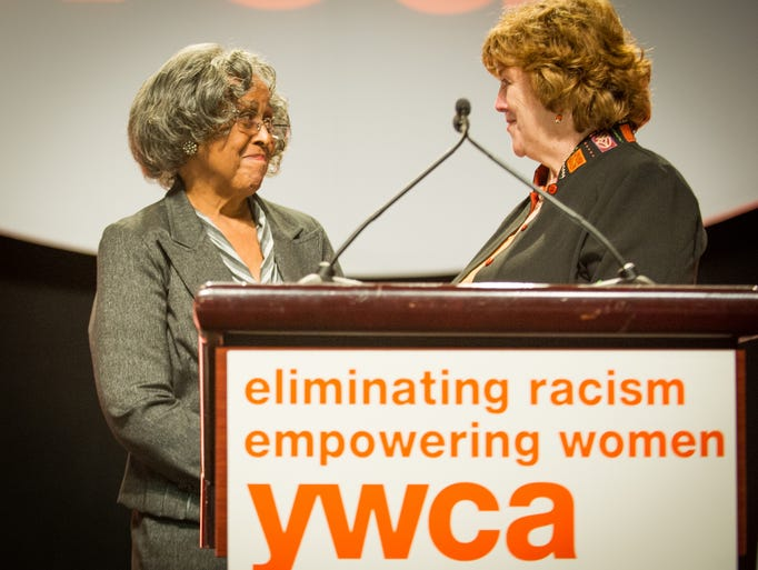 YWCA President Jean Carroll, right, presents the 2013 Empowering Women award to Dr. Ruth Scott, of Rochester, during the YWCA's 7th annual Empowering Women Luncheon Tuesday at the Rochester Riverside Convention Center.