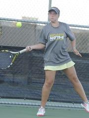 Abilene High's Rachel Tebow hits a forehand to Cooper's