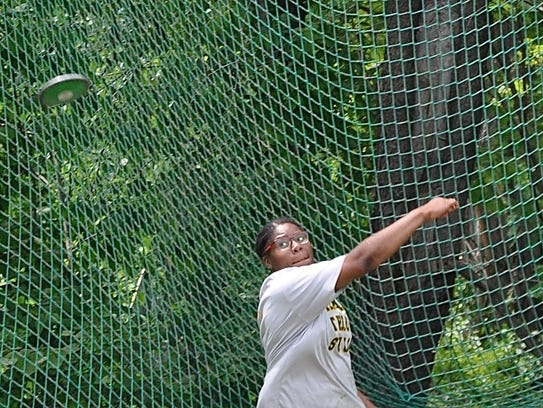 Ramapo's Shiana Galette throw the discus during the
