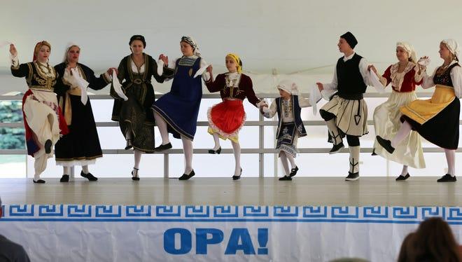 St. Spyridon Greek Orthodox dancers perform at Greekfest Saturday June 24, 2017 at Deland Park in Sheboygan, Wis.