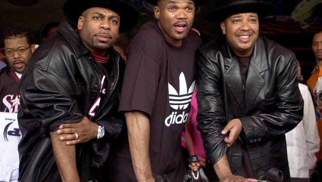 "File photo taken in 2002 shows hip hop pioneers RUN-DMC, from left, the late Jason ""Jam Master Jay"" Mizell, Darryl ""DMC"" McDaniels, and Joseph ""DJ Run"" Simmons as they create hand prints in cement at Hollywood's RockWalk in Los Angeles."