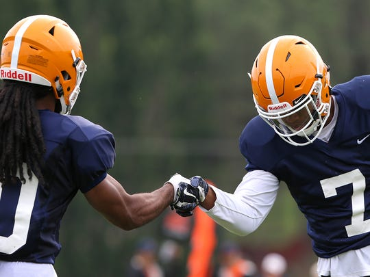 UTEP wide receivers Kavika Johnson, right, and Warren