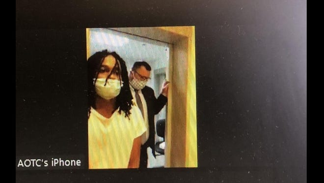 Yohanes Jones of Webster, left, is joined by his lawyer, Michael Callahan, at a Zoom video arraignment in the July10 stabbing at the Auburn Mall.