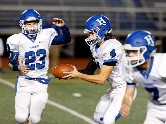 Horseheads' Jack Chalk hands off the ball to Bryan Smith during Friday's game versus Binghamton on October 27, 2017.