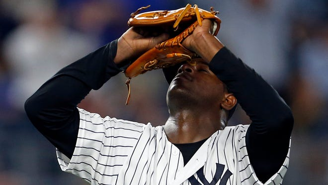 New York Yankees relief pitcher Luis Severino reacts during the eighth inning of a baseball game against the Toronto Blue Jays on Wednesday, Sept. 7, 2016, in New York.